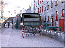 W8873 : The waterwheel which drove the malt grinding stones at the Midleton Distillery by Jim Woodward-Nutt