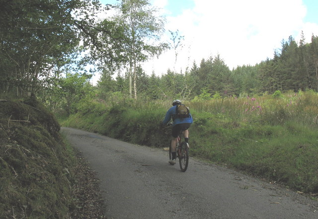 Rider on the steep hill leading to Bwlch Cwmheisian