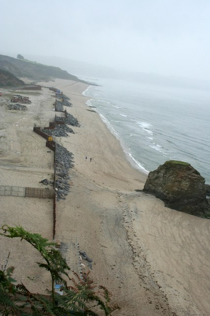 The beach and its temporary reinforced sea wall