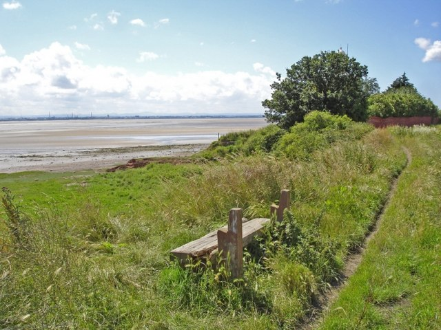 Backless bench beside the Mersey Way, Hale