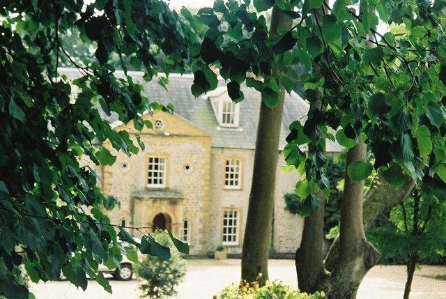 Slape Manor through the trees