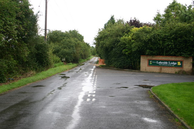 Fen Road passes the entrance to Lakeside Lodge