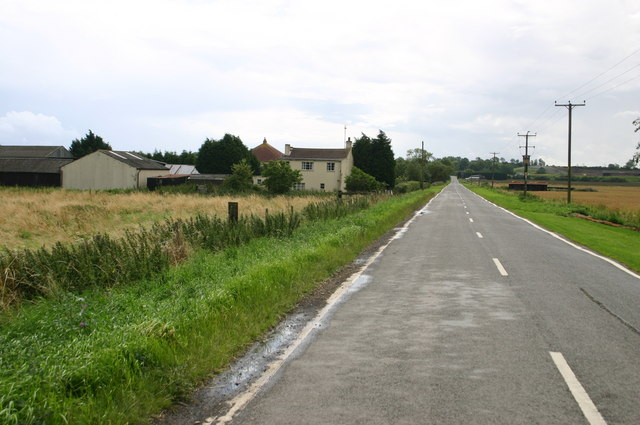The road to Warboys passes Rose Cottage farm