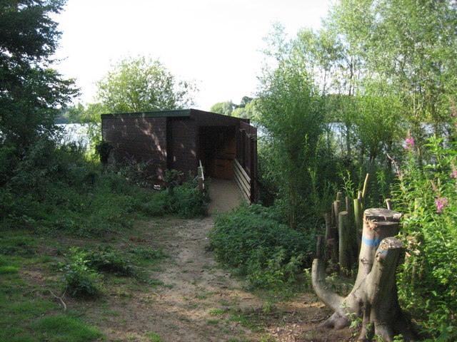 Bird hide on the shores of Alton Water in Larch Wood