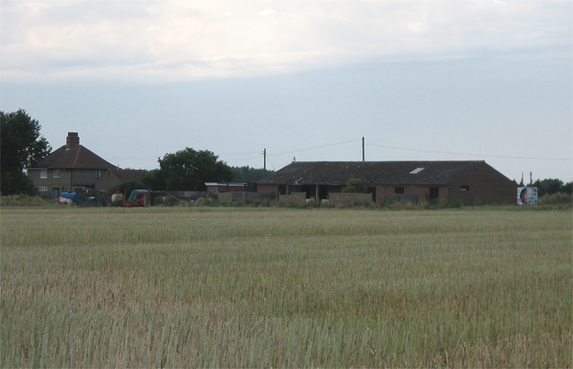 Hill Farm across stubble field