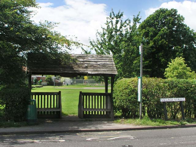 Combined bus shelter and roofed gate