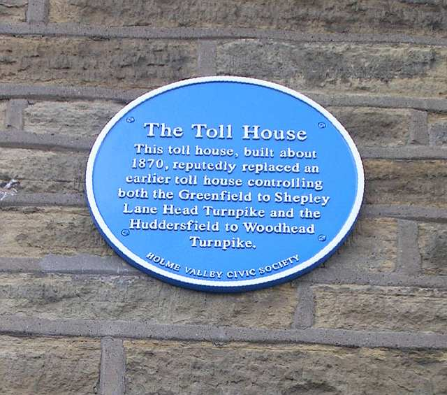 Blue Plaque on wall of Toll House Bookshop