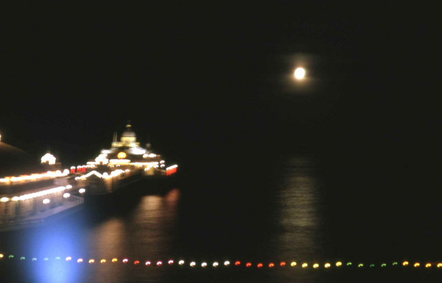 Moon shimmering on the English Channel  alongside Eastbourne Pier