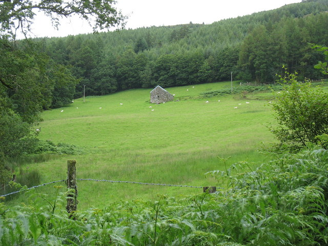 Field, forest and stone barn