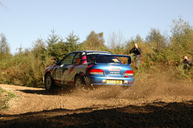 Rally car negotiating junction in Cropton Forest