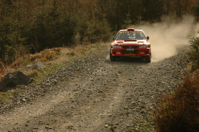 rally car hanging on to the forest track in Whitehaugh