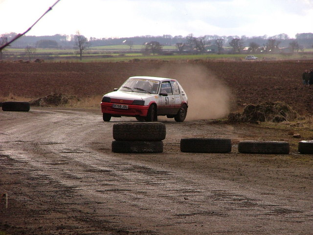 A rally car on one of the perimeter roads at the ex-airfield at Charterhall