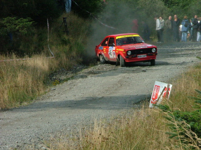Rally car coming round a junction in Glentrool Forest