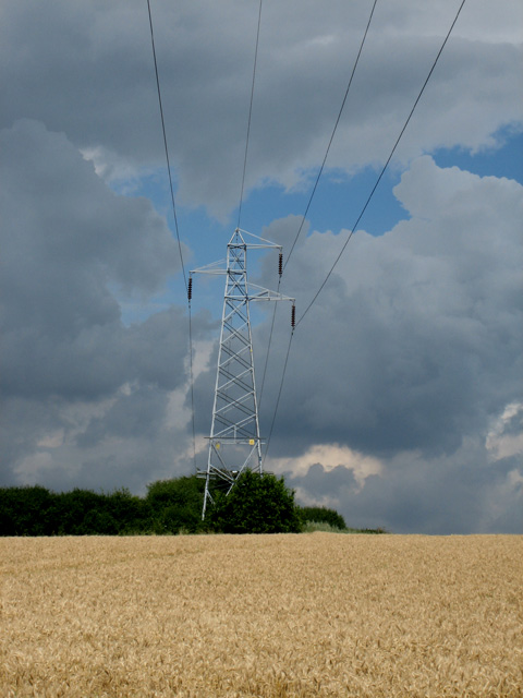 Pylon carrying high-tension power line over path