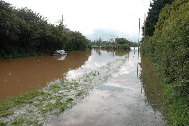 Abandoned vehicle  in floods outside Upton upon Severn
