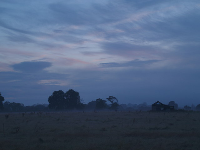 Disused barn in the early morning mist