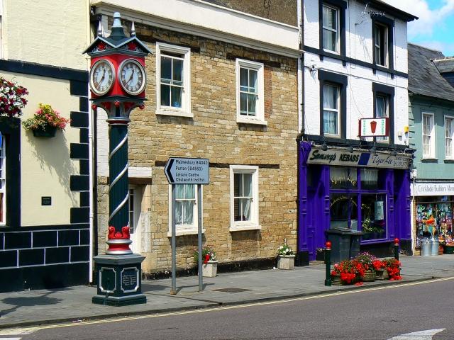 Shops and Queen Victoria memorial clock, High Street, Cricklade
