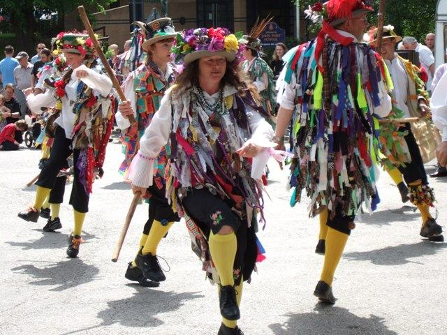 Morris dancers during well dressing, Etwall