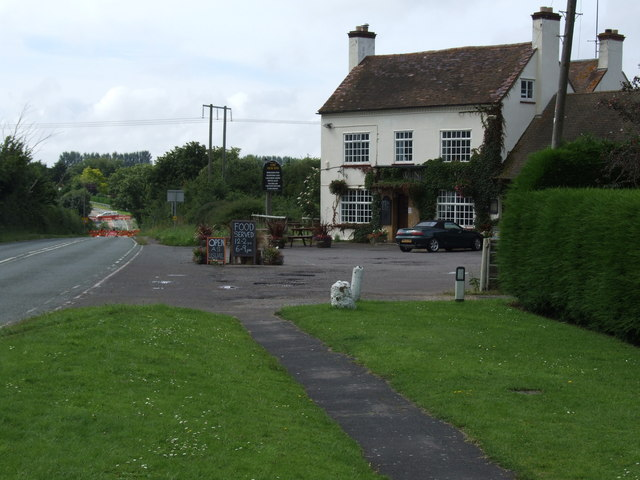 Hole in the road near the New Inn