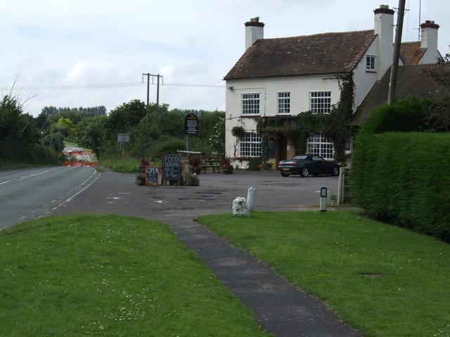 Hole in the road near the New Inn