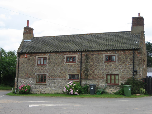 Decorative brickwork on fine house at T-junction