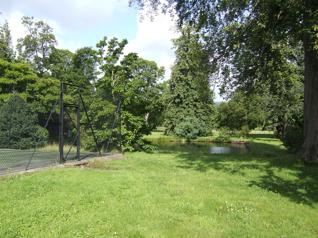 Pond and tennis court at Ty Uchaf