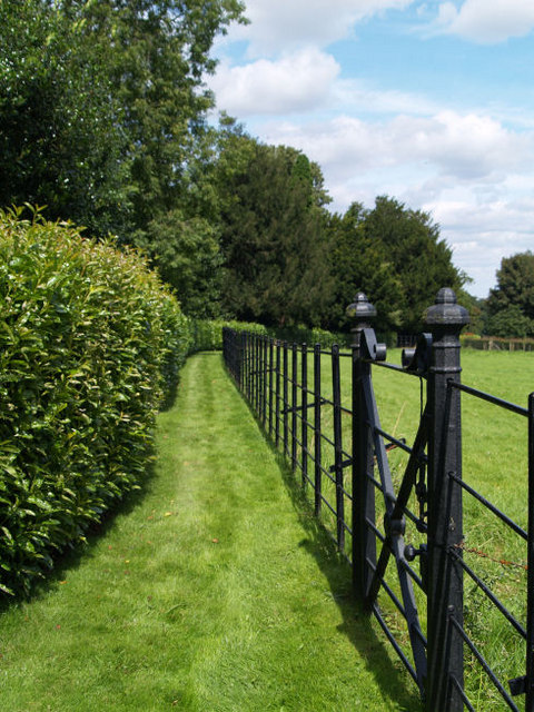 Boundary fence and gate at Brodsworth Hall.