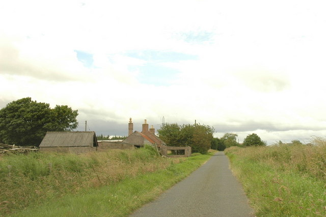 Minor road and farm cottage.
