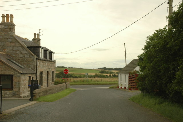 Road junction and houses at Longdrum