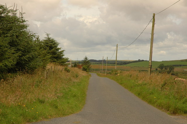 Road and partially hidden houses at Backhill of Overhill