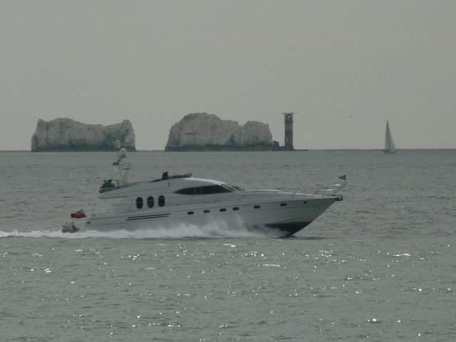 A powerboat passes The Needles
