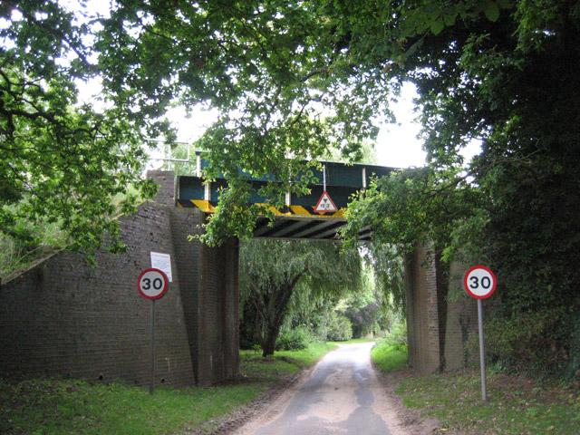 Railway bridge as you enter Antingham