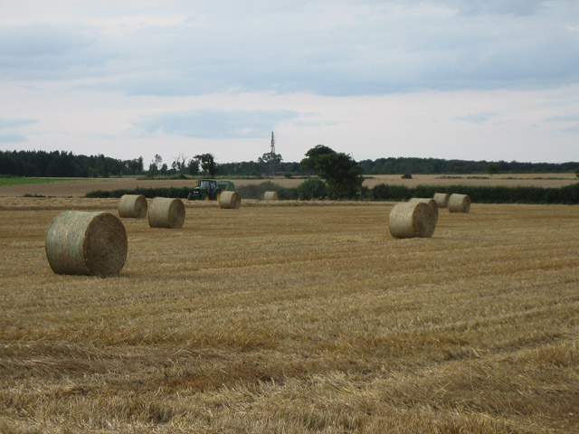Baling straw in an empty square