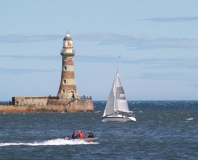 Roker North lighthouse with yacht.