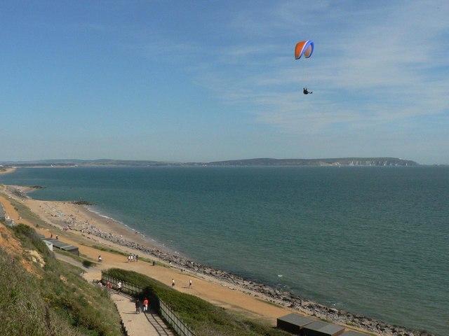 Barton on Sea: beach, paraglider, view