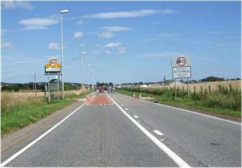 Entry to St Cyrus on A92 from SW
