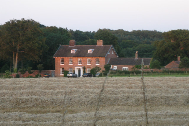Fine house across the harvest field