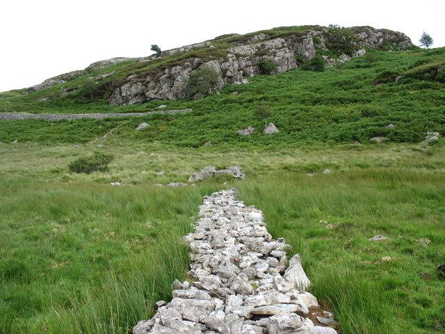 A stone causeway across the bog below Muriau'r Gwyddel