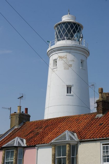 Lighthouse over house tops