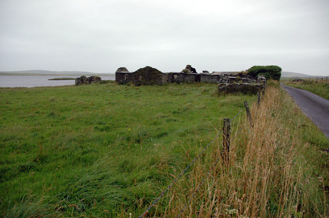 Old house by shore of Harray Loch