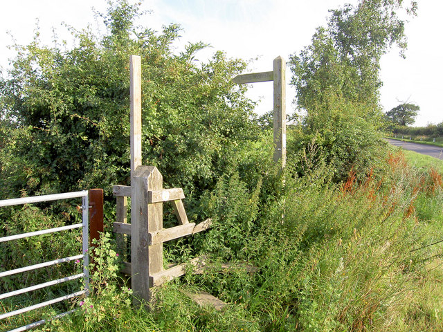 Stile and footpath sign.