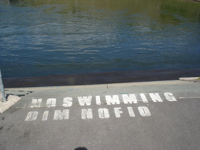 Bilingual sign by canoeing lakes