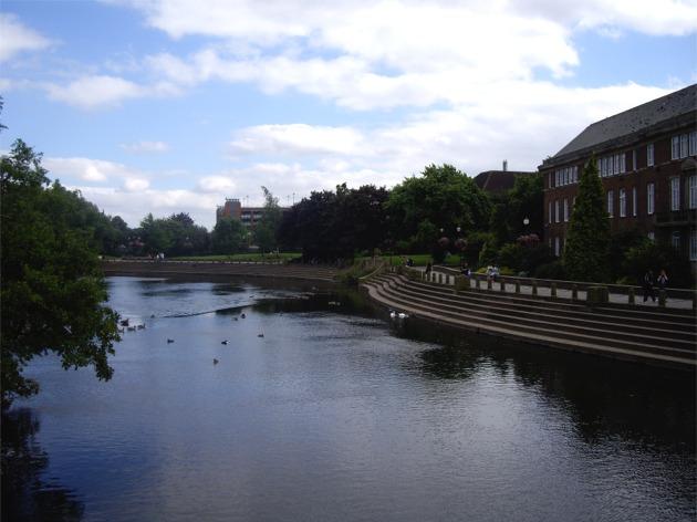 River Derwent flowing past embankment, Derby city centre
