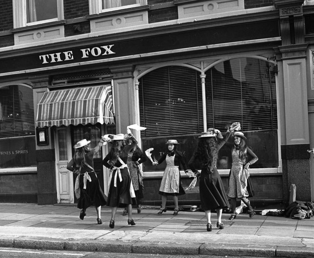 Folk dancers outside 'The Fox', Islington Green