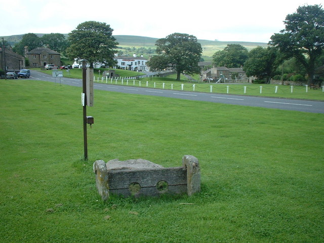 Ancient stocks on village green in Bainbridge