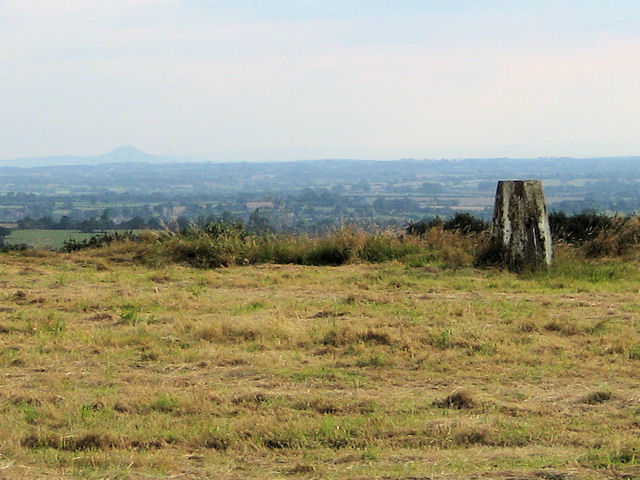 Trig Point With The Wrekin In The Distance