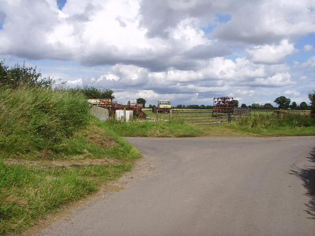 Farm machinery at the road junction