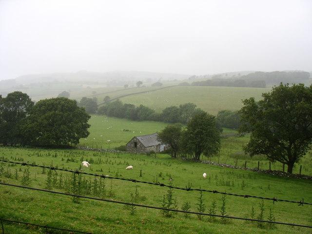 A barn on a hillside above Afon Prysor