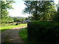 SX0374 : Littlewood Farm west entrance by William Bartlett