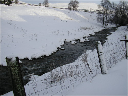 Burn at Dalwhinnie Distillery in snow